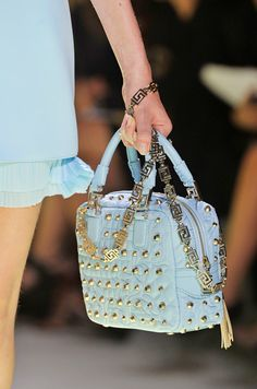 FINISHING TOUCHES    PASTEL BAGS  Sorbet-coloured accessories in bite sizes are a welcome palette cleanser.    VERSACE
