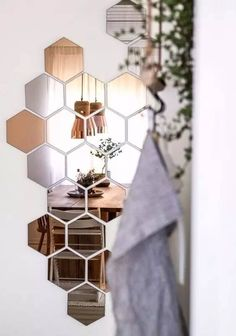 love the idea of honeycomb mirrors for the front hall // zink