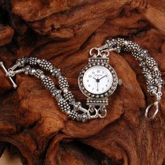 """This sparkling double strand hand beaded watch band will dazzle the crowds. Watch band made of sterling silver bali beads with comet argent Swarovski crystal and sterling silver toggle clasp. Geneva watch movement.    Watch face measures approximately 3/4""""    Watch band measures approximately 7""""    Custom orders are welcome at Makana Jewelry Designs!"""