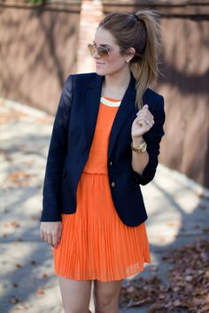 Should've cuffed the right sleeve too but navy and orange is always on point