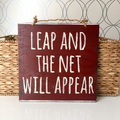 A personal favorite from my Etsy shop https://www.etsy.com/listing/253326262/leap-and-the-net-will-appear-sign-wood