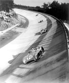Juan-Manuel Fangio leading team mate Stirling Moss on the renewed Monza banking during the 1955 Italian Grand Prix, the first time the banking was used together with the normal track since 1933  1955 was also the year Monza saw the premiere of the now legendary Parabolica corner (where the old double right hander of Curva Sud was transformed in one long sweeping corner)    Juan-Manuel Fangio, Mercedes-Benz W196, 1955 Italian Grand Prix, Monza