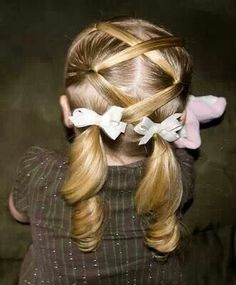 Cute little girl hairstyle, if Mickey Mouse us long enough I might be able to do this one in a couple of years...