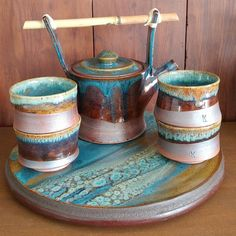 #TeapotTuesday   This is a set by a local #ncpotter that I was given as a gift. Made by Karen Lewit Designs   What I think is brilliant is the matching tile she made to mount on the lazy Susan.   #handmade #potterycollection #potterycollector