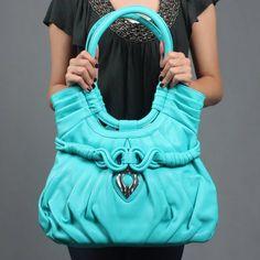 big turquoise purse! cute!