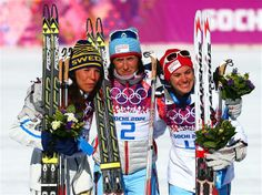DAY 2:  (L-R) Silver medalist Charlotte Kalla of Sweden, gold medalist Marit Bjoergen of Norway and bronze medalist Heidi Weng of Norway celebrate on the podium during the flower ceremony for the Ladies' Skiathlon 7.5 km Classic + 7.5 km Free