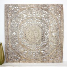Using recycled rough hewn teak planks from old dwellings and community buildings, hill tribe craftsmen devote endless hours to hand carve, sand, and wax this intricate lotus flower motif. To Thais, the lotus symbolizes prosperity and fertility.