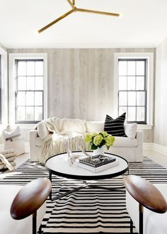 Glam living room with wood walls