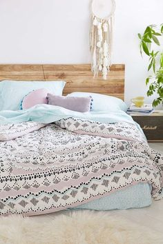 I want to get or make a wooden head board kind of like this one but to match my hope chest: