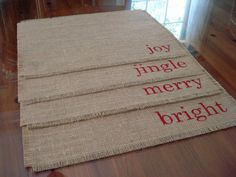 Set of 4 frayed edge burlap reversible placemats hand painted with the words joy, jingle, merry, and bright in red for Christmas. Each place Christmas Placemats, Christmas Sewing, Rustic Christmas, Christmas Side, Christmas Projects, Burlap Christmas Decorations, Christmas Holidays, Christmas Crafts, Simple Christmas