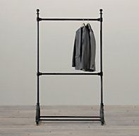 RH's Vintage Tailors Rack 3':Handcrafted from foundry-cast iron and distressed by hand, our rolling racks re-create the character and quality of tailor's racks used a century ago. Ample strength makes them a practical choice for hanging garments and stacked cases, and their authentic welded joinery, ball finials and arched bases elevate them to decorative accents.