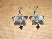 Large silver flowers and black Swarovski crystal beads. Silver fish hook earring. Price: $6.00
