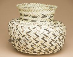 This is a unique southwest Tarahumara Indian hand woven basket. This basket was made by the tarahumara Indians using fibers from the indigenous yucca plant. This Native technique of basket making is g