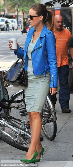She's a winner: The 29-year-old actress caught attention in a good way with that blue leather jacket, green heels and light blue-green dress...
