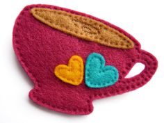 Pink Felt Teacup Brooch with Yellow & Blue Heart Detail - Love Afternoon Tea Christmas Gift Ideas for Her (Under 15 Dollars / 10 Pounds). £6.00, via Etsy.