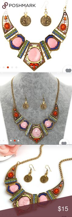 Crystal Stone Necklace w/Earrings Crystal Stone Jewelry Necklace w/Earrings. This necklace makes a bold statement w/ multicolored stones that's sure to give a hint of playfulness to any outfit. Let's not forget that this necklace comes with a beautiful pair of earrings. Jewelry Necklaces