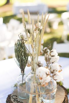 simple rustic centerpiece with cotton   Jess Barfield #wedding