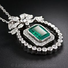 Edwardian Emerald and Diamond Pendant Necklace, A deep rich emerald cut emerald weighing approximately carats dangles freely from a classic Edwardian set bow and inside a horseshoe shape frame of high quality, bezel set old mine diamonds. Emerald Necklace, Emerald Jewelry, Diamond Pendant Necklace, Diamond Jewelry, Diamond Rings, Emerald Gemstone, Diamond Stud, Edwardian Jewelry, Antique Jewelry