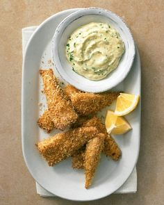 Panko-Crusted Fish Sticks with Herb Dipping Sauce (1 large egg, salt & pepper, 2 cups panko, Old Bay Seasoning, olive oil, 1 1/2 lb tilapia fillets, cut into wide strips, light mayonnaise, fresh parsley, and Dijon mustard)