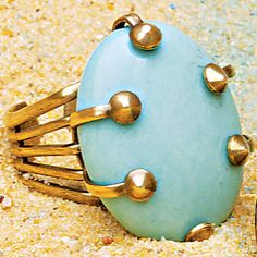 Turquoise Adjustable Ring.      Choose from one of our adjustable brass rings that will be perfect for your everyday outfit. Beautiful and edgy our blue turquoise stone is the hottest color of the season. While the neutral tones of the yellow jade and turquoise with the rosette design is a classic.
