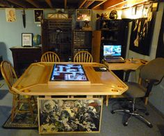 A well-organized game room, with a custom built touch-screen table. It looks like a great place! Board Game Table, Board Games, Game Tables, Tv Tables, Tabletop Rpg, Tabletop Games, Touch Screen Table, Dnd Table, Gaming Desk