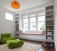 Built in bookcase and a window seat for reading
