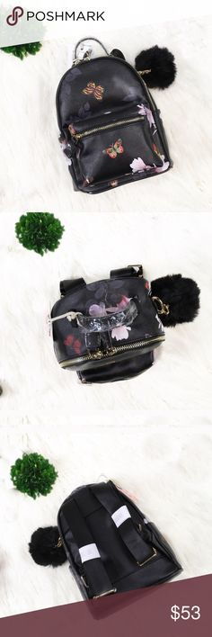 """NEW """"Jasmine"""" Vegan Leather Mini Pom Backpack Trendy mini Pom backpack features a floral and butterfly print design. Large main pocket & inside small pocket with a zipper closure. Small pocket outside w zipper closure. Gold colored details. ❤️FREE DETACHABLE POM INCLUDED❤️ 10x4 in Bags Backpacks"""