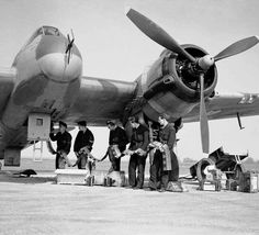 This is Bristol Beaufighter Mk VIF of No 96 squadron being re-armed at Honily in Warwickshire 23 March Armourers are feeding belts of ball and high-explosive incendiary ammunition into the magazines of the aircraft's Hispano cannon. Bristol Beaufighter, Ww2 Aircraft, Military Aircraft, Ww2 Planes, Vintage Airplanes, Battle Of Britain, Royal Air Force, World War Two, Wwii