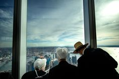 A new skyline rises over an old world.  Seen here, a Amish family looks out into a mysterious world of modern life.  This photograph was taken in the newly built Freedom Tower in New York City.