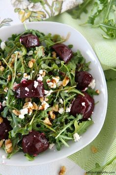 Whatever you think about beets, you definitely need to give this Balsamic Beet Salad with Arugula, Goat Cheese and Walnuts a try. So delicious! | Featured on The Best Blog Recipes