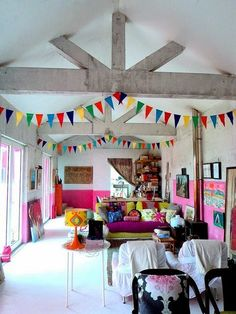 Creating a living room that doesn't centre around the TV - creative living spaces, love this colourful room with the bunting, inspired interiors