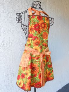 Apron with Gerber Daisies is reversible with a full skirt and rick rack by judarose on Etsy
