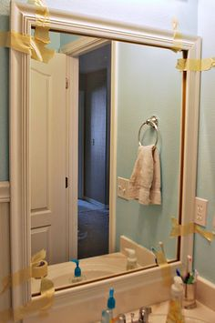 Tutorial on how to frame a mirror with molding for $10. Say goodbye to boring bathroom mirrors.