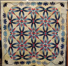Wedding Star by Tammy Zanella, Guild of Quilters of Contra Costa County (California).  Based on Judy Niemeyer's Bali Wedding Star design; machine trapunto quilting