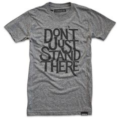 """""""Don't just stand there"""" typo tee"""