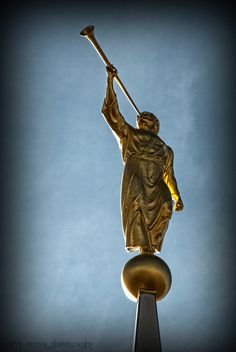 The Angel Moroni statue atop the Rexburg Idaho Temple holds nothing but a trumpet declaring the restored, everlasting gospel.  Each statue symbolizes the angel of the Restoration as seen in vision by John the Revelator.