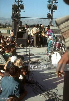 Rock guitarist Jimi Hendrix performs onstage with his Fender Stratocaster electric guitar at the Newport Pop Festival on June 20 1969 in Devonshire...