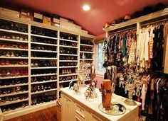 How I would love to have a closet big enough for an island!