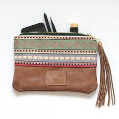 repurposed pouch - leather from vintage jackat and tribal fabric from old vest
