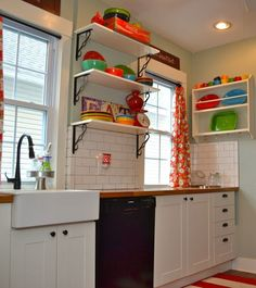 a bright and colorful kitchen with open shelves to display the most colorful pieces.