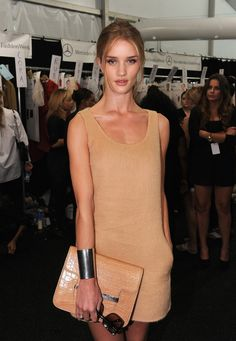 Rosie Huntington-Whiteley.  Love the honeycomb colour + the bracelet!