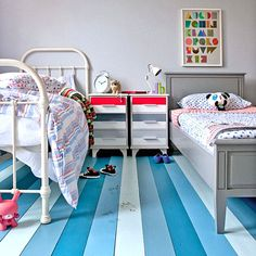 Mismatched beds, painted floor that is easily cleaned, lots of colors and a ton of ease.  Perfect bedroom for kids who share...