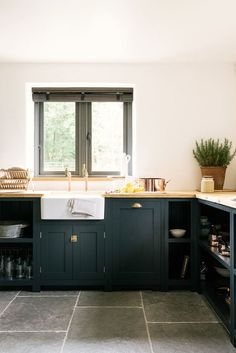 Recently we've become obsessed with one kitchen cabinet color. This rich, luxurious peacock-y hue is that happy place between navy and hunter green. Here are a handful of kitchens that have us seriously craving dark teal cabinets.
