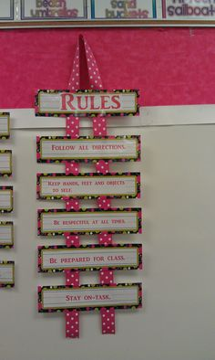 cute way to display classroom rules. easy display that doesn't take up much space on the wall.