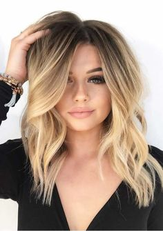 29 Creative Medium Length Blonde Haircuts to Show Off in 2018. Medium length hairstyles are suitable hairstyles for ladies who want to wear every green popular haircuts in 2018. The women who already have medium length hair and dont know how to choose the best hair colors they can visit here to see the best blonde hair color trends for medium and shoulder length haircuts in 2018.