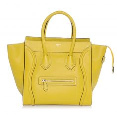 This is an authentic CELINE Drummed Leather Mini Luggage in Citron. The exceptional features and superior quality of this Celine tote luggage bag lend a sophisticated chic look for travel or everyday excursions.