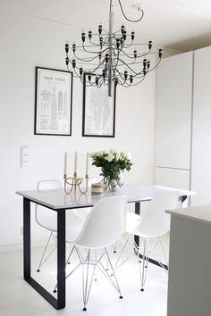 Homevialaura | modern white kitchen | dining space | Compac Quartz in calacatta marble | Flos 2097/30 | Lexington Home coffee mugs |  Svenskt Tenn Vänskapsknuten | Eames DSR