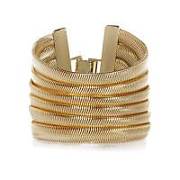 Gold tone slinky gateway bracelet