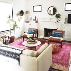 Top Tones: Proving that you don't need to match colors to round out a look, instead this room matches tones for a killer aesthetic. A bright pink rug is ...