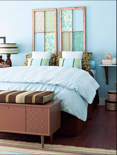 Mod Podge beautiful scrapbook paper or wall paper scraps on to the glass of old windows and hang as a headboard! #GoodIdeas